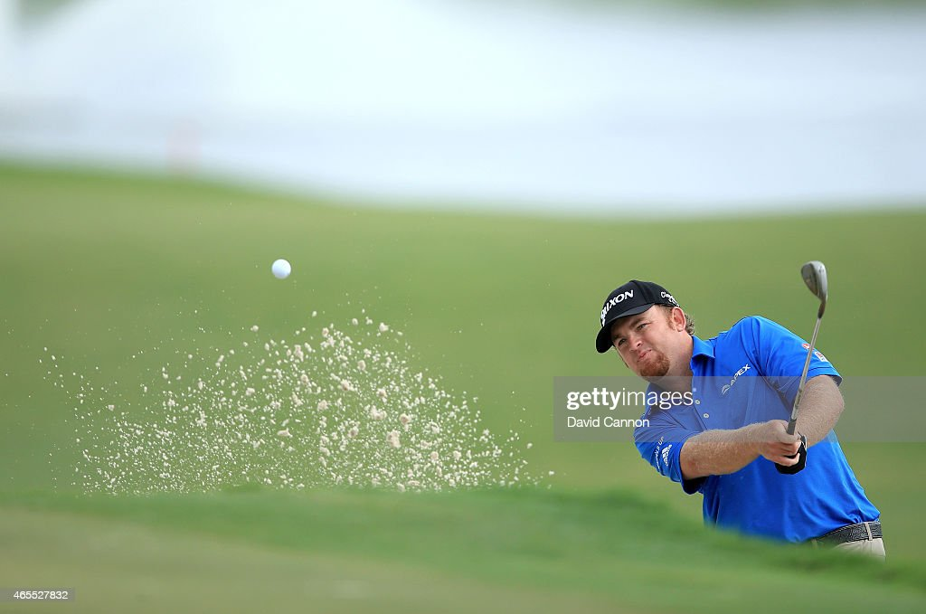 Holmes of the USA plays his fourth shot on the par 5 10th hole during the third round of the World Golf ChampionshipsCadillac Championship at Trump...