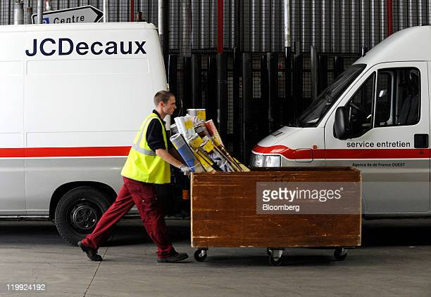 A JCDecaux employee transports advertising posters at the company's depot in Gennevilliers France on Tuesday July 26 2011 JCDecaux is the world's...