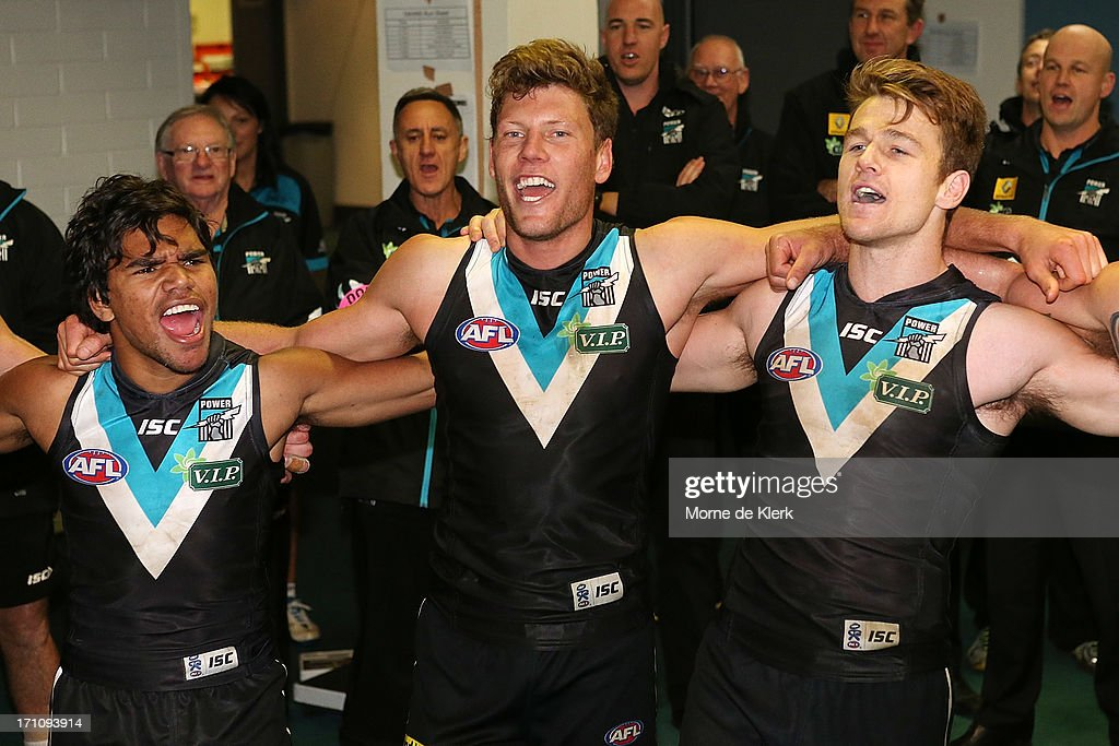 Jeake Neade (L), Brad Ebert (C) and Robbie Gray (R) of the Power celebrates after the round 13 AFL match between Port Adelaide Power and the Sydney Swans at AAMI Stadium on June 22, 2013 in Adelaide, Australia.
