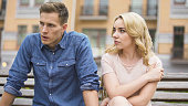 Jealous girl having fight with upset boyfriend, conflict of unhappy people