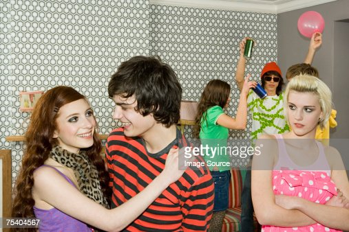 Jealous girl looking at a couple : Stock Photo