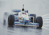 Jean Alesi of France drives the Mild Seven Benetton Renault Benetton B196 Renault V10 in the rain during the Spanish Grand Prix on 2nd June 1996 at...