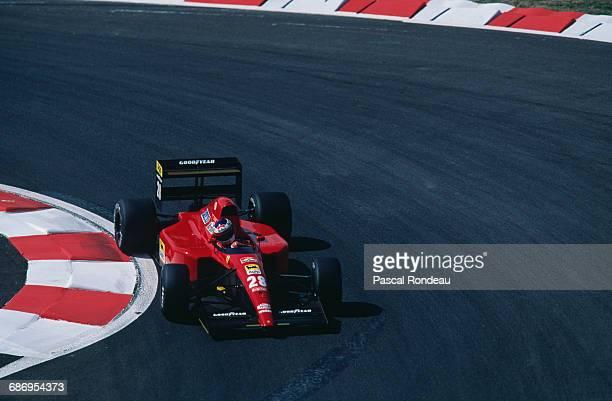 Jean Alesi of France drives the Scuderia Ferrari SpA Ferrari 643 Ferrari V12 during practice for the French Grand Prix on 6 July 1991 at the Circuit...