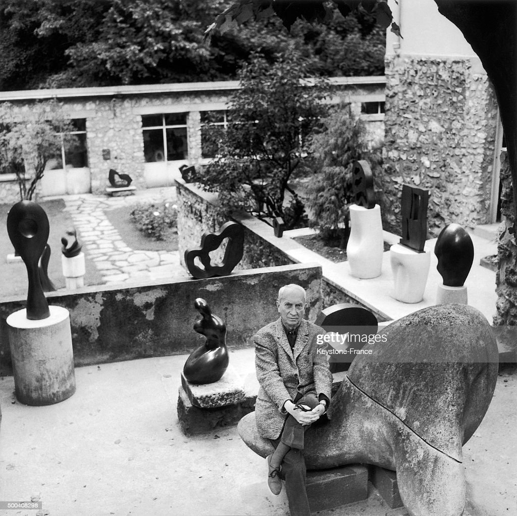 Jean Arp in the garden of his house with some of his sculptures circa 1960 in Clamart, France.