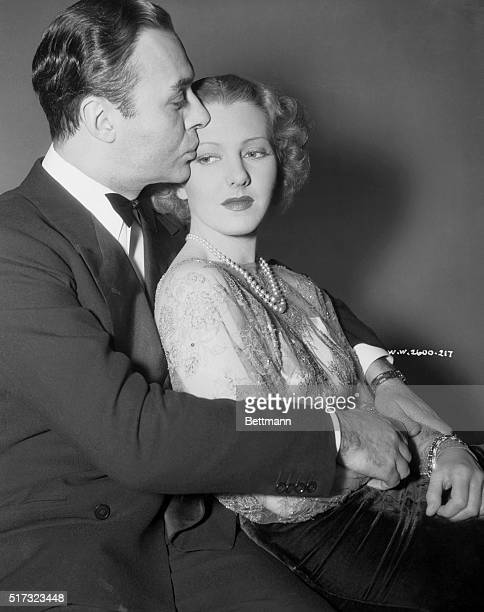 Jean Arthur and Charles Boyer movie stars indulging in a 'Hollywood' kiss January 1938