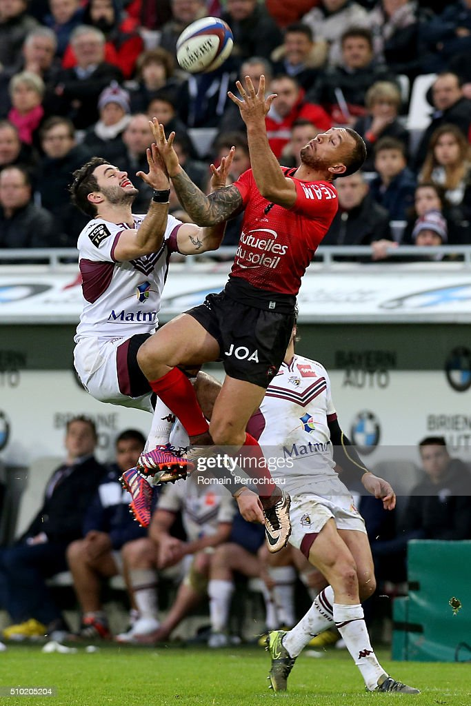 Jean Baptiste Dubie of Union Bordeaux Begles and <a gi-track='captionPersonalityLinkClicked' href=/galleries/search?phrase=Quade+Cooper&family=editorial&specificpeople=4176008 ng-click='$event.stopPropagation()'>Quade Cooper</a> of RC Toulon in action during the Top 14 rugby match between Union Bordeaux Begles and RC Toulon at Stade Matmut Atlantique on February 14, 2016 in Bordeaux, France.