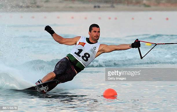 Jean Baptiste Faisy of France competes in the men's slalom heat of the waterskiing finals event during the XVI Mediterranean Games on June 29 2009 in...