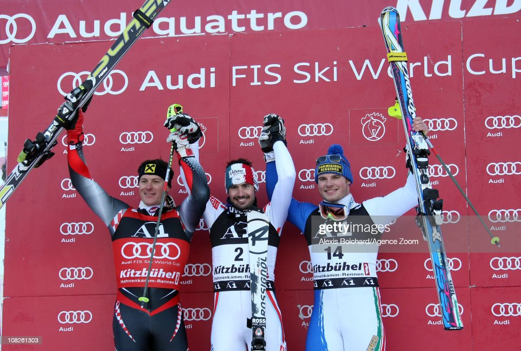 Jean Baptiste Grange of France1st, <a gi-track='captionPersonalityLinkClicked' href=/galleries/search?phrase=Ivica+Kostelic&family=editorial&specificpeople=241265 ng-click='$event.stopPropagation()'>Ivica Kostelic</a> of Croatia 2nd and <a gi-track='captionPersonalityLinkClicked' href=/galleries/search?phrase=Giuliano+Razzoli&family=editorial&specificpeople=4835259 ng-click='$event.stopPropagation()'>Giuliano Razzoli</a> of Italy 3rd celebrate after the Audi FIS Alpine Ski World Cup Men's Slalom on January 23, 2011 in Kitzbuehel, Austria.