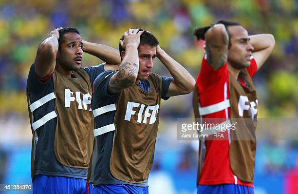 Jean Beausejour Carlos Carmona and Jorge Valdivia of Chile looks on in front of the bench during the 2014 FIFA World Cup Brazil Round of 16 match...