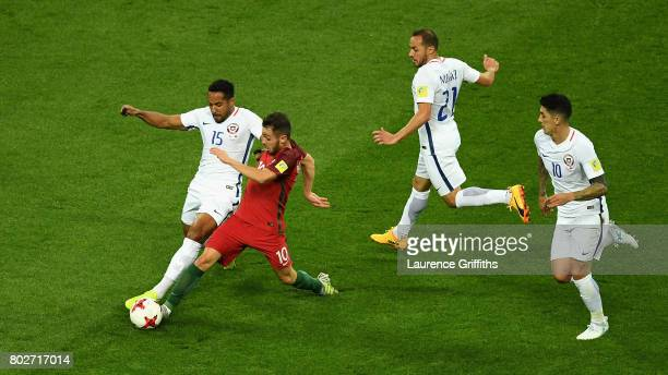 Jean Beausejour of Chile and Bernardo Silva of Portugal battle for possession during the FIFA Confederations Cup Russia 2017 SemiFinal between...