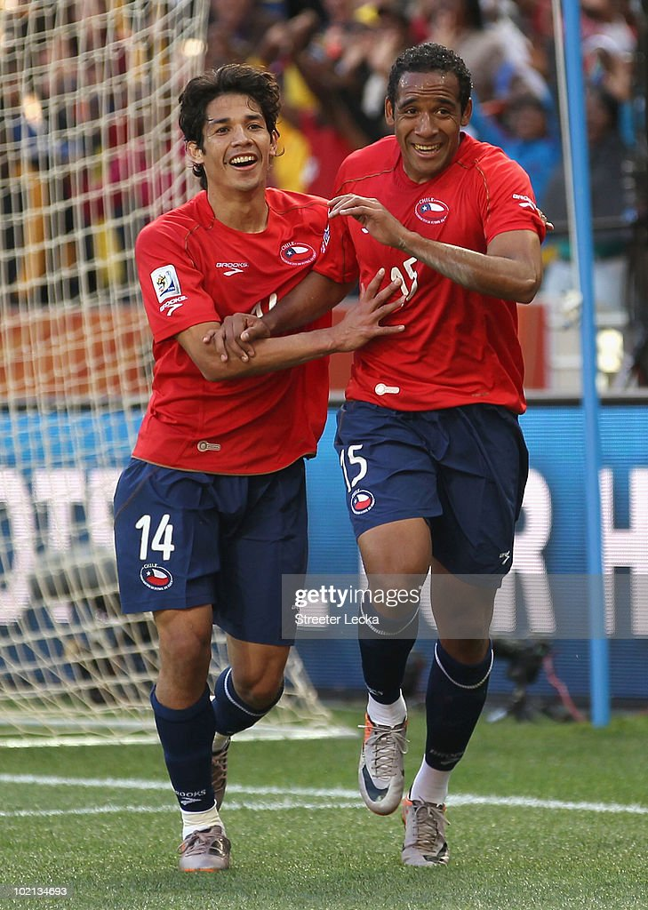 Jean Beausejour of Chile celebrates scoring the opening goal with team mate Matias Fernandez during the 2010 FIFA World Cup South Africa Group H...