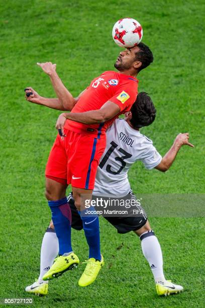Jean Beausejour of Chile competes with Lars Stind of Germany during FIFA Confederations Cup Russia final match between Chile and Germany at Saint...