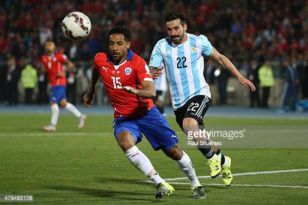 Jean Beausejour of Chile fights for the ball with Ezequiel Lavezzi of Argentina during the 2015 Copa America Chile Final match between Chile and...