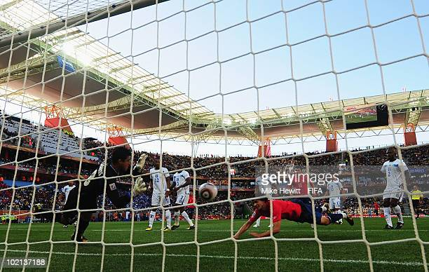 Jean Beausejour of Chile scores the opening goal against goalkeeper Noel Vallardes of Honduras during the 2010 FIFA World Cup South Africa Group H...