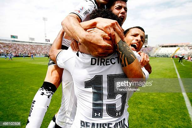 Jean Beausejour of Colo Colo celebrates with teammates after scoring the opening goal during a match between U de Chile and ColoColo as a part of 11...