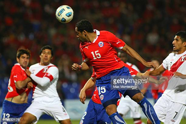 Jean Beausejourof Chile battles for the ball against Josepmir Ballón of Peru during a match as part of group C of 2011 Copa America at Malvinas...
