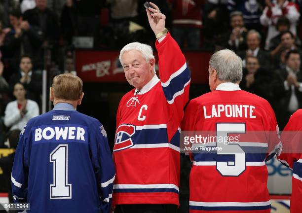 Jean Beliveau formerly of the Montreal Canadiens salutes the crowd prior to a game against the Toronto Maple Leafs as the teams salute their Original...