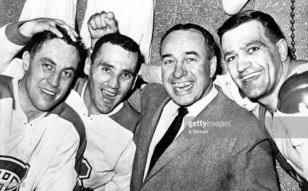 Jean Beliveau #4, <a gi-track='captionPersonalityLinkClicked' href=/galleries/search?phrase=Jacques+Plante&family=editorial&specificpeople=227203 ng-click='$event.stopPropagation()'>Jacques Plante</a> #1, head coach Toe Blake and Bernie Geoffrion #5 of the Montreal Canadiens celebrate their last victory of the season against the Detroit Red Wings on March 19, 1961 at the Detroit Olympia Stadium in Detroit, Michigan.