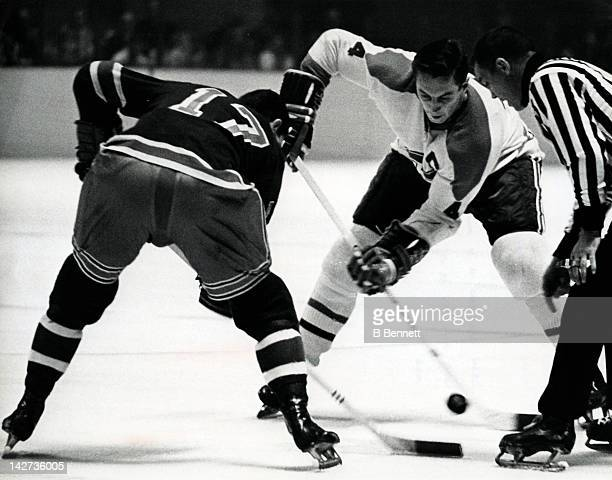 Jean Beliveau of the Montreal Canadiens and Lou Angotti of the New York Rangers faceoff during their game on October 24 1965 at the Madison Square...
