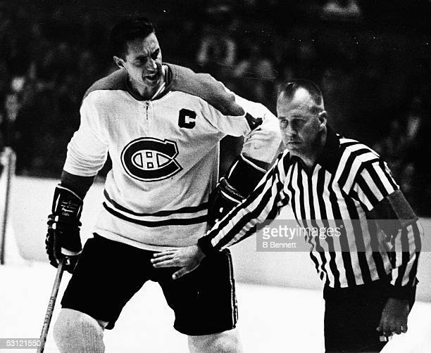 Jean Beliveau of the Montreal Canadiens argues with the referee during an NHL game against the New York Rangers on October 24 1965 at the Madison...