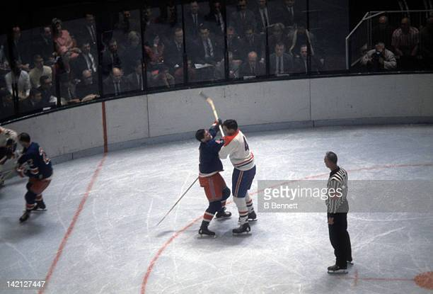 Jean Beliveau of the Montreal Canadiens checks Arnie Brown of the New York Rangers during their game on April 3 1971 at the Montreal Forum in...
