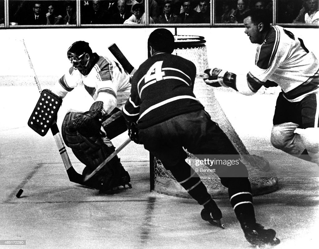 Jean Beliveau #4 of the Montreal Canadiens goes after the puck as his former teammates goalie <a gi-track='captionPersonalityLinkClicked' href=/galleries/search?phrase=Jacques+Plante&family=editorial&specificpeople=227203 ng-click='$event.stopPropagation()'>Jacques Plante</a> #30 and Doug Harvey #2 of the St. Louis Blues defend the net on November 9, 1968 at the Montreal Forum in Montreal, Quebec, Canada. The Canadiens defeated the Blues 4-1.