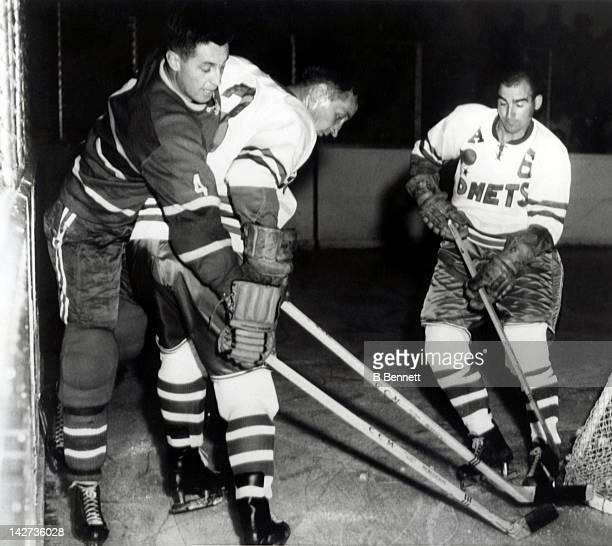 Jean Beliveau of the Montreal Canadiens is tied up behind Spokane's goal during an exhibition game between the National Hockey League Montreal...