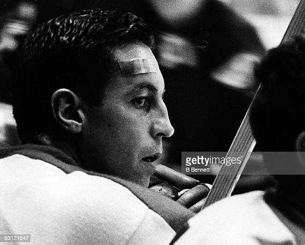 Jean Beliveau of the Montreal Canadiens looks on from the bench during an NHL game against the New York Rangers on October 24 1965 at the Madison...