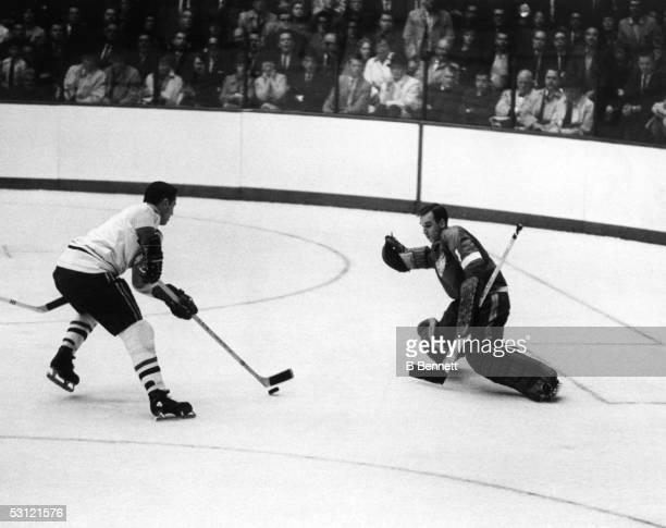 Jean Beliveau of the Montreal Canadiens looks to score on goalie Roger Crozier of the Detroit Red Wings during Game 3 of the 1966 Stanley Cup Finals...