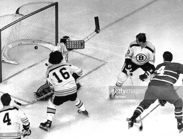 Jean Beliveau of the Montreal Canadiens scores on goalie Ed Johnston of the Boston Bruins as Dallas Smith Derek Sanderson and Bobby Orr look on...