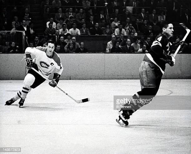 Jean Beliveau of the Montreal Canadiens skates on the ice as Arnie Brown of the New York Rangers defends on October 24 1965 at the Madison Square...
