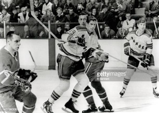 Jean Beliveau of the Montreal Canadiens tries to tie up Jean Ratelle of the New York Rangers as Gilles Tremblay of the Canadiens and Vic Hadfield of...