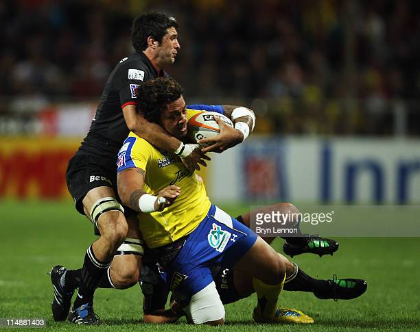 Jean Bouilhou and JeanMarc Doussain of Stade Toulousain Rugby challenge Sione Lauaki of ASM Clermont Auvergne during the French Top 14 Semi Final...