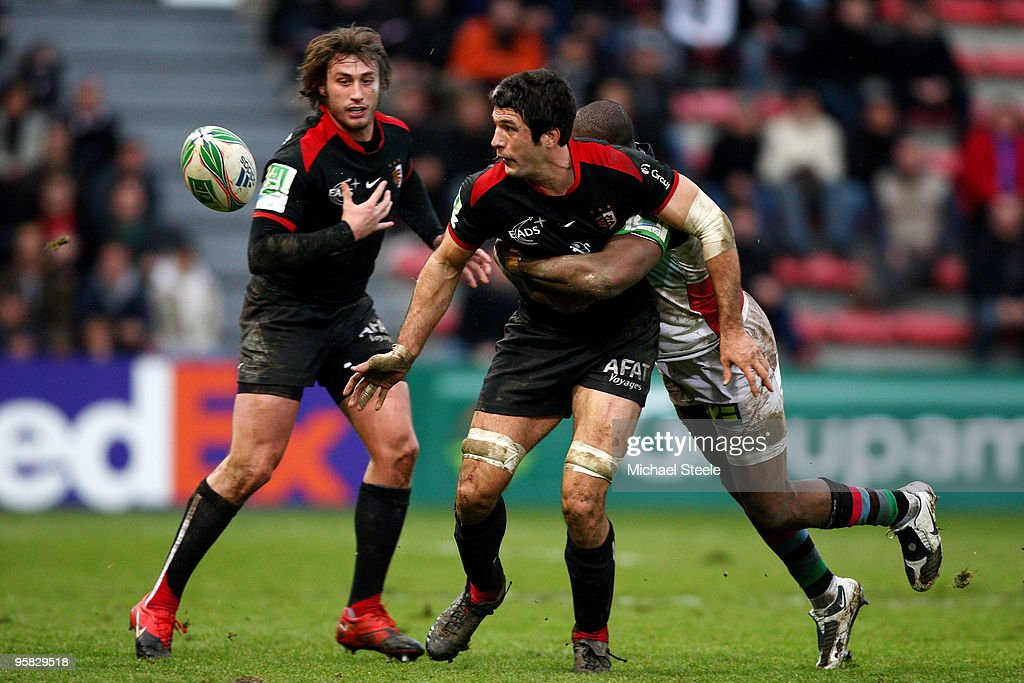 <a gi-track='captionPersonalityLinkClicked' href=/galleries/search?phrase=Jean+Bouilhou&family=editorial&specificpeople=572048 ng-click='$event.stopPropagation()'>Jean Bouilhou</a> of Toulouse offloads the ball despite the challenge of <a gi-track='captionPersonalityLinkClicked' href=/galleries/search?phrase=Ugo+Monye&family=editorial&specificpeople=221264 ng-click='$event.stopPropagation()'>Ugo Monye</a> (r) as <a gi-track='captionPersonalityLinkClicked' href=/galleries/search?phrase=Maxime+Medard&family=editorial&specificpeople=832902 ng-click='$event.stopPropagation()'>Maxime Medard</a> (l) looks on during the Toulouse v Harlequins Heineken Cup Pool 5 match at the Stade Ernest Wallon on January 17, 2010 in Toulouse, France.