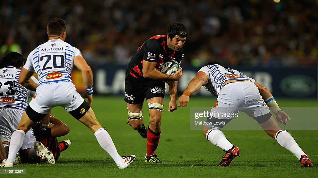 Jean Boulihou of Toulouse looks to beat the tackles from Roy Kockott (No 20) and Matemini Masoe of Castres during the French Top 14 Semi Final match between Toulouse and Castres Olympique at Stade de Toulouse on June 2, 2012 in Toulouse, France.