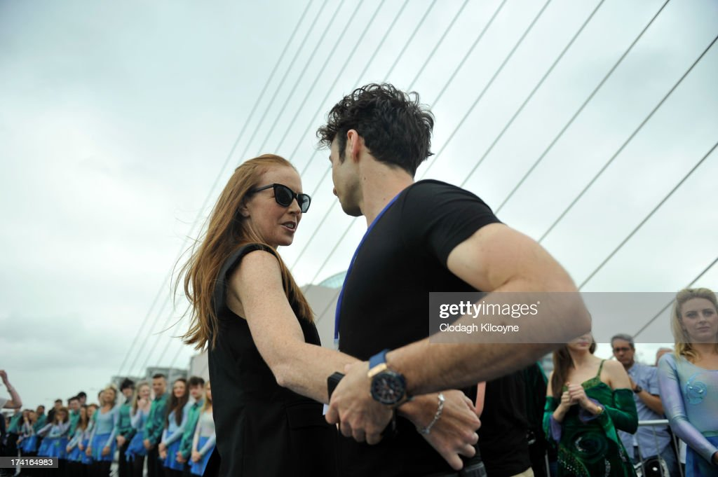 Jean Butler and Padraic Moyles lead Irish dancers to break the World Record for the number of dancers in a continuous line with a total of 1693 people from 44 countries Irish Dancing on the bank of the River Liffey to perform the Riverdance as part of the Gathering, a year-long tourism drive to entice people around the world with Irish links to visit the country on July 21, 2013 in Dublin, Ireland. The previous record of 652 people dancing in a continuous line was held by Nashville, Tennessee.