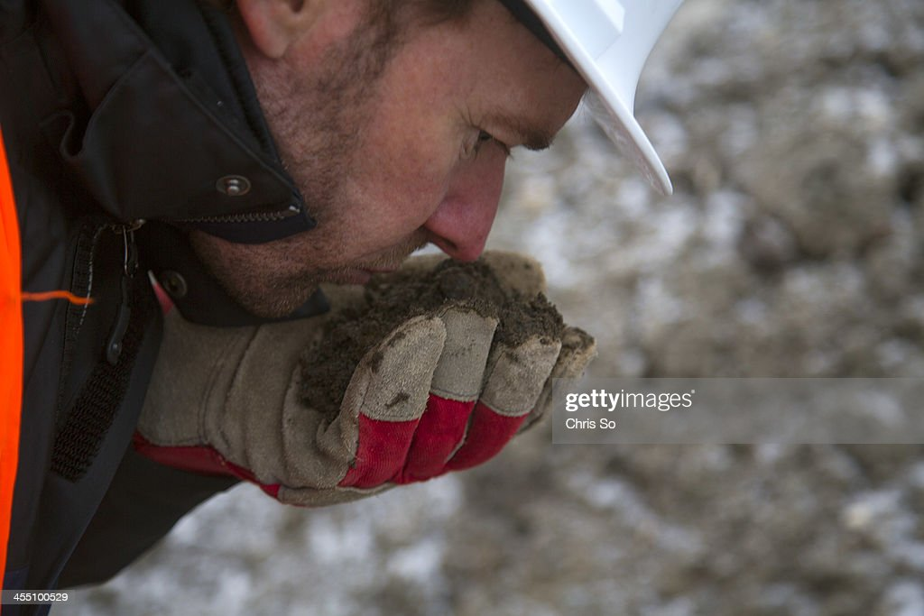Jean Campagna Urgent Environment Technician for the Province of Quebec checks the smell of contaminated soil being stored just north of the...