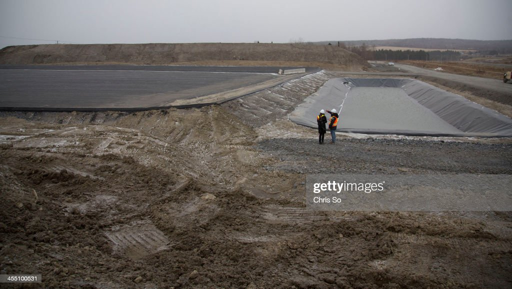Jean Campagna Urgent Environment Technician for the Province of Quebec points to a 7 meter high mound of contaminated soil far back that had been...