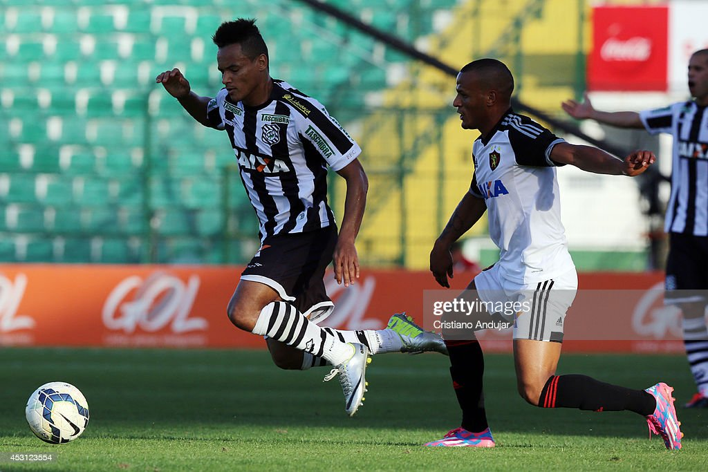 Jean Carlos #9 of Figueirense goes to the ground after touch of Patric #12 of Sport during a match between Figueirense and Sport as part of Campeonato Brasileiro 2014 at Orlando Scarpelli Stadium on August 3, 2014 in Florianopolis, Brazil