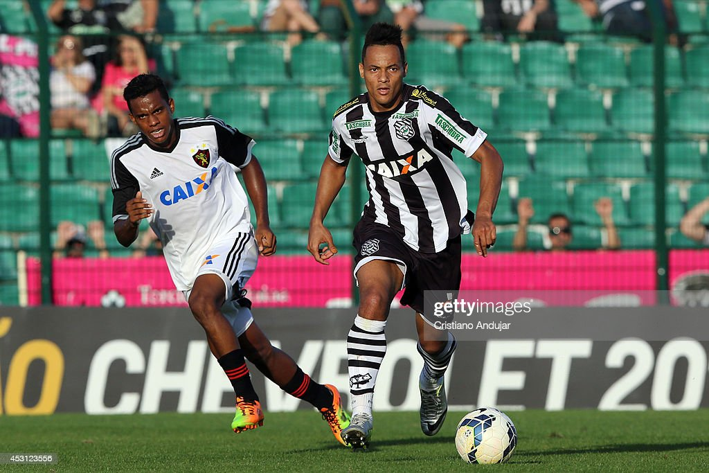 Jean Carlos #9 of Figueirense run with Rithely #21 of Sport behind during a match between Figueirense and Sport as part of Campeonato Brasileiro 2014 at Orlando Scarpelli Stadium on August 3, 2014 in Florianopolis, Brazil