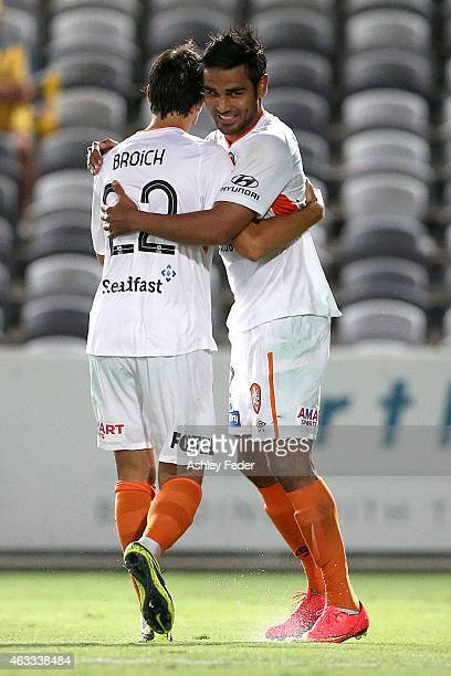 Jean Carlos Solorzano celebrates a goal with Thomas Broich of the Roar during the round 17 ALeague match between the Central Coast Mariners and the...