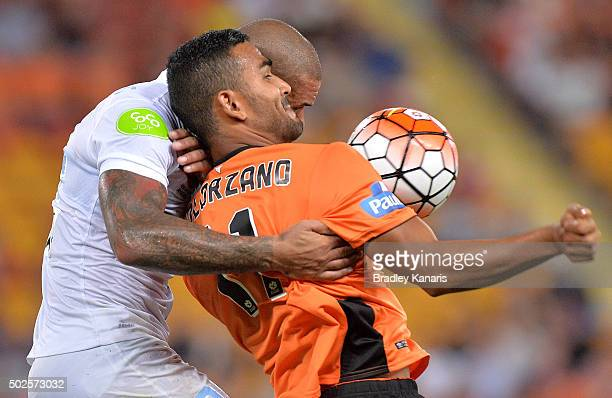 Jean Carlos Solorzano of the Roar and Patrick Kisnorbo of Melbourne City challenge for the ball during the round 12 ALeague match between the...