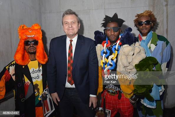 Jean Charles de Castelbajac poses with African 'Sapeurs artists' walk the runway during 'Le Bord Des Mondes' Press Preview And African 'Sapeurs'...