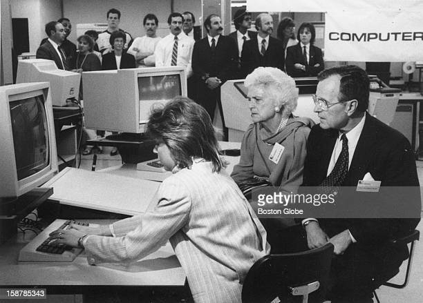 Jean Chinetti software engineer gives a CAD/CAM computer graphics demonstration to Vide President George HW Bush and his wife Barbara Bush