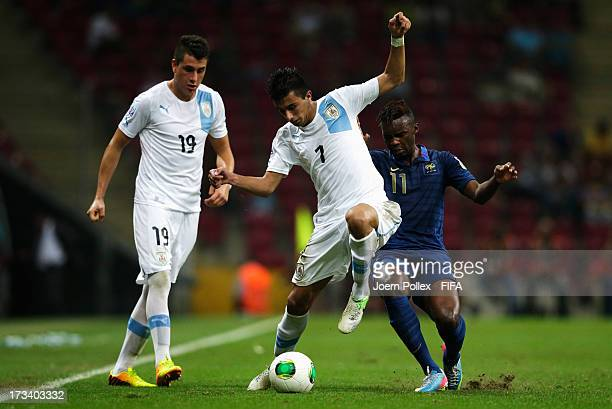 Jean Christophe Bahebeck of France and Gaston Silva of Uruguay compete for the ball during the FIFA U20 World Cup Final match between France and...