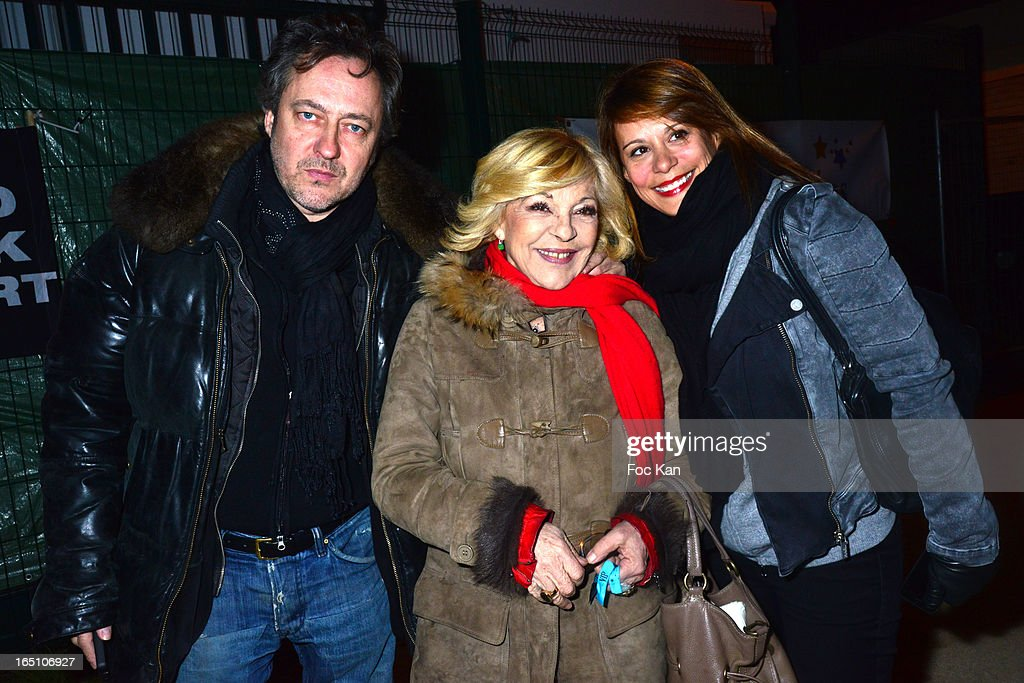 Jean Christophe Molinier, Nicoletta and a guest attend 'Les Toiles Enchantees' Children Care Association Auction Dinner During The 50th Foire du Trone at Pelouse de Reuilly on March 29, 2013 in Paris, France.