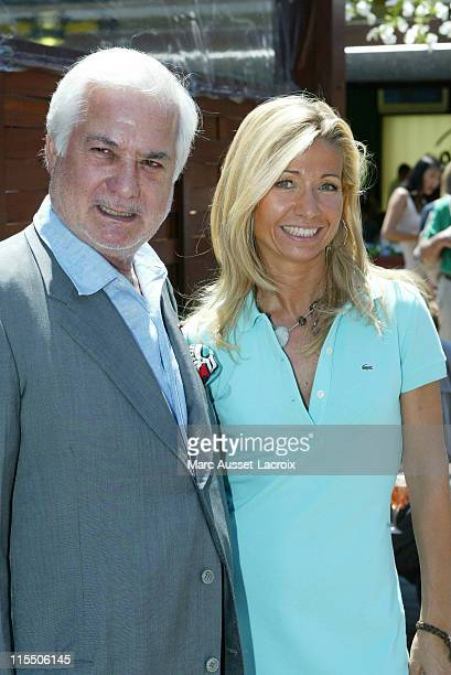 Jean Claude Brialy and Natty Belmondo during 2006 French Open Celebrity Sightings June 9 2006 at The Village Roland Garros in Paris France