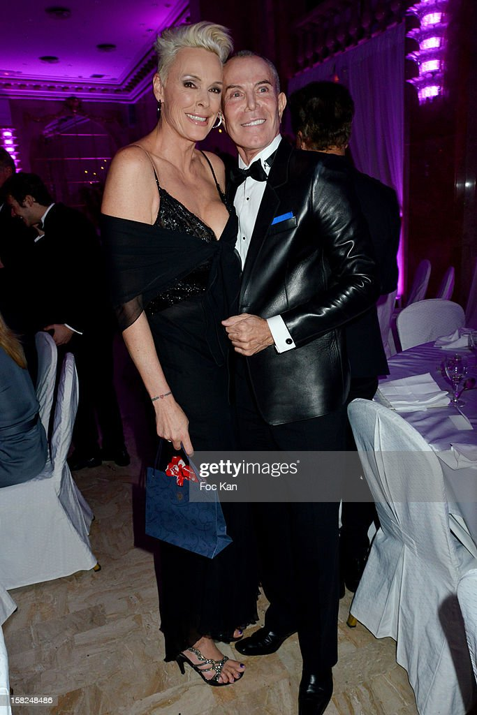 Jean Claude Jitrois (R) and Brigitte Nielsen attend the The Bests Awards 2012 Ceremony at the Salons Hoche on December 11, 2012 in Paris, France.