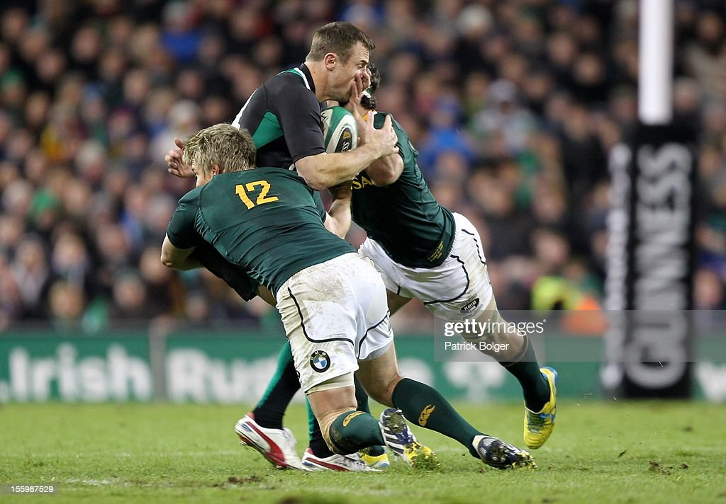 Jean De Villiers and Marcell Coetzee of South Africa with <a gi-track='captionPersonalityLinkClicked' href=/galleries/search?phrase=Tommy+Bowe&family=editorial&specificpeople=556065 ng-click='$event.stopPropagation()'>Tommy Bowe</a> of Ireland during the International rugby match between Ireland and South Africa in the Aviva Stadium on November 10, 2012 in Dublin, Ireland.