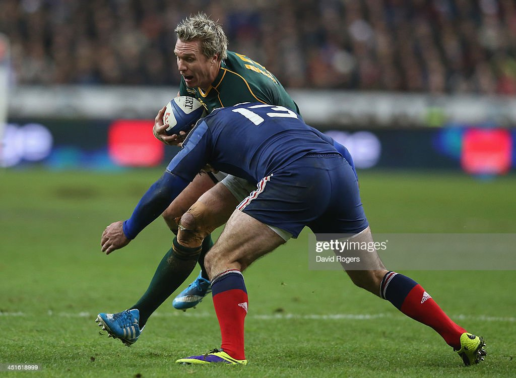<a gi-track='captionPersonalityLinkClicked' href=/galleries/search?phrase=Jean+de+Villiers&family=editorial&specificpeople=2285701 ng-click='$event.stopPropagation()'>Jean de Villiers</a> of South Africa is tackled by <a gi-track='captionPersonalityLinkClicked' href=/galleries/search?phrase=Florian+Fritz&family=editorial&specificpeople=540919 ng-click='$event.stopPropagation()'>Florian Fritz</a> during the International match between France and South Africa at Stade de France on November 23, 2013 in Paris, France.